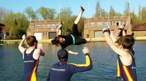 The Men 'B' crew ceremonially tosses Stef Wragg (cox) into the Isis after earning blades in City Bumps 2015.